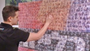 Man with mosaic wall