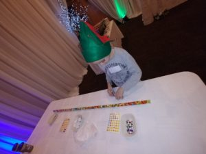 Child with candy line on table
